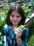 """Students were eager to show me all of the different vegetables in the garden. When asked what her favorite activity has been at summer program, sixth grader, Kassandra, says """"I like planting in the garden best."""""""