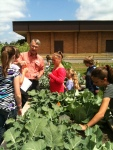 The TOGETHER! program at Rainier Elementary School takes a trip to the community garden where students learn that some flowers are edible!