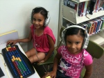 Two girls enjoy the listening station at the new Buena Library, which opened 2 months ago after 10 years of community advocacy and fundraising. What a great literacy resource!