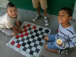 A friendly game of checkers. During free time each day, children can choose from a plethora of activties. Marbles, legos, and jump rope are also quite popular.