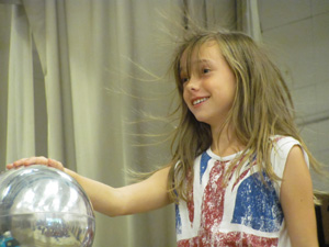 This girl had a hair-raising experience with Pacific Science Center's Van de Graaff generator.